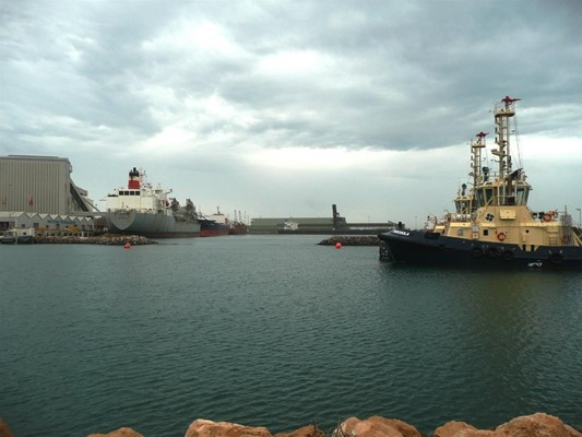 General - Full port with tugs